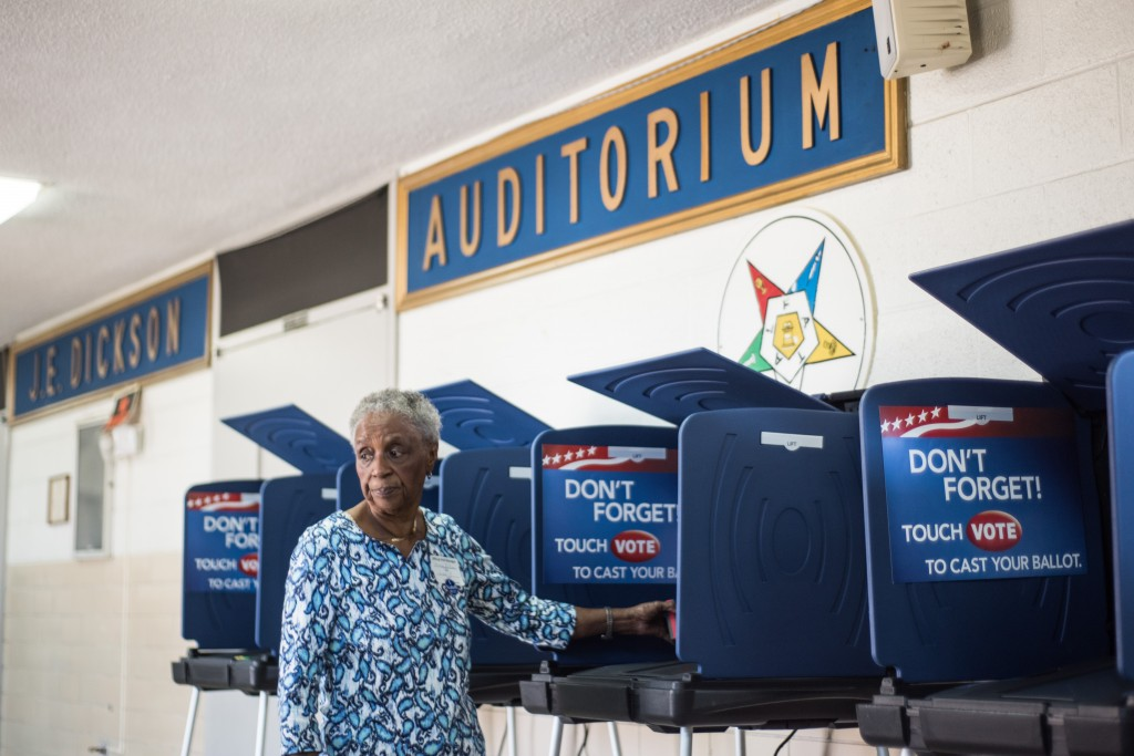 Poll worker Mary Ellison prepares a voting machine at the Prince Hall Masonic Lodge during the South Carolina Democratic Presidential Primary February 27, 2016 in Columbia, South Carolina. Many American voting machines are more than 10 years old, raising concerns that they may not be reliable. Sean Rayford/Getty Images)