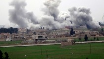 """A picture taken on February 27, 2016 in Akcakale in Sanliurfa province shows smoke rising from the neightbourhood of Syrian city Tel Abyad during clashes between Islamic State Group and People's Protection Units (YPG). ussian Foreign Minister Sergei Lavrov and US Secretary of State John Kerry """"hailed"""" the ceasefire in Syria and discussed ways of supporting it through cooperation between their militaries, Russia's foreign ministry said on February 27, 2016. / AFP / STR        (Photo credit should read STR/AFP/Getty Images)"""