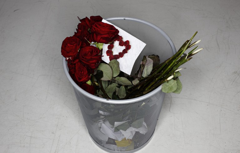 Disposed rose bouquet and valentine card