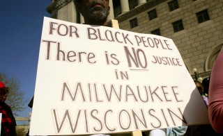 Milwaukee, Wisc. is 40 percent black, but disparities in incarceration, education and housing... (Photo by Darren Hauck/Getty Images)
