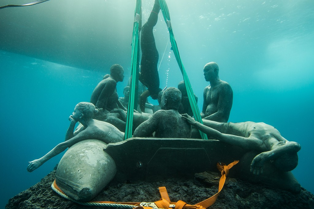 """The Raft of Lampedusa"" is lowered to the ocean floor. Photo by Jason deCaires Taylor"