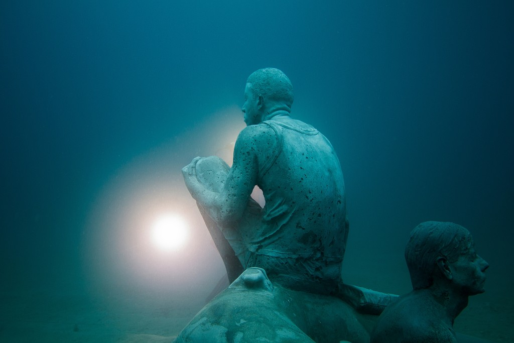 "Close-up on a figure from ""The Raft of Lampedusa."" Photo by Jason deCaires Taylor"