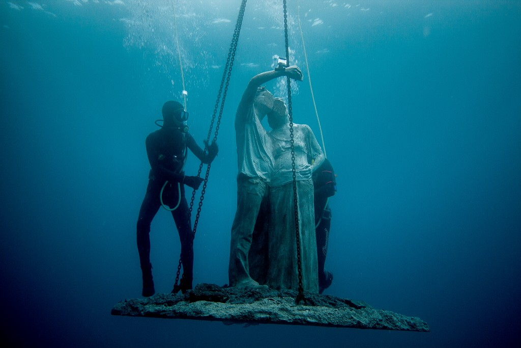 "Figures from the ""Rubicon"" are lowered into the water. Photo by Jason deCaires Taylor"