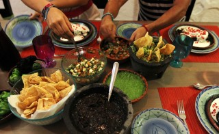 To visit Mexico is to eat your way through Mexico. Pictured here are chiles en nogada, guacamole, homemade salsas and ensalada de nopales. Photo by Margaret Myers