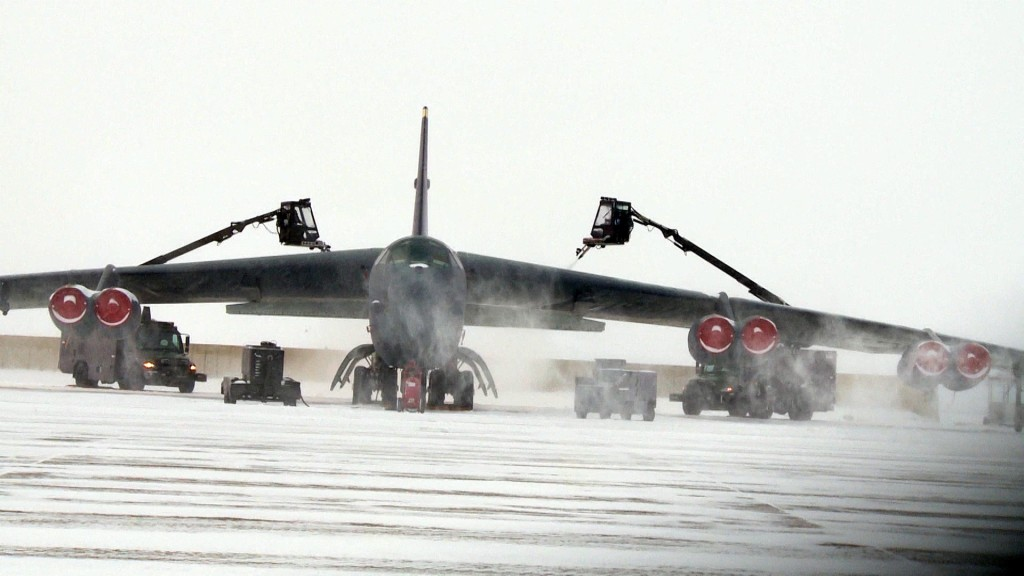 B-52H bomber on the tarmac at Minot Air Force base is sprayed down with de-icing fluid. Photo by Jamie McIntyre