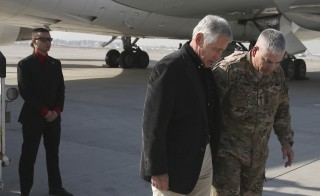 Gen. John F. Campbell, right, greets former Defense Secretary Chuck Hagel in Kabul on Dec. 6, 2014.  Campbell said Tuesday that he did not believe the war in Afghanistan was a lost cause. Photo by Mark Wilson/Reuters (AFGHANISTAN - Tags: MILITARY) - RTR4GXOI