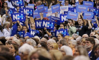 Supporters of U.S. Democratic presidential candidate Hillary Clinton and U.S. Senator Bernie Sanders hold signs at the New Hampshire Democratic Party State Convention in Manchester, New Hampshire September 19, 2015. Photo by Brian Snyder/Reuters