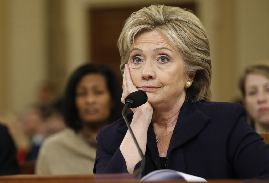 Democratic presidential candidate Hillary Clinton listens to a question as she testifies before the House Select Committee on Benghazi, on Capitol Hill in Washington October 22, 2015. The congressional committee peppered Clinton with questions about her email use and handling of the deadly 2012 attack on the U.S. diplomatic mission in Benghazi, Libya, when she was the secretary of state.         Photo by Jonathan Ernst/REUTERS