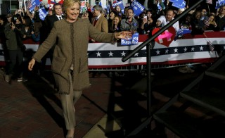 U.S. Democratic presidential candidate Hillary Clinton takes the stage to rally with supporters at an outdoor plaza in Columbia, South Carolina February 26, 2016. Photo By Jonathan Ernst/Reuters