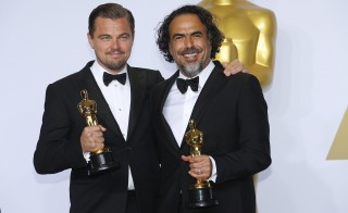 """Leonardo DiCaprio and Alejandro G. Inarritu pose with their Oscars earned for """"The Revanent."""" Photo by Mike Blake/Reuters"""