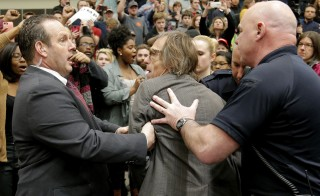 Photographer Christopher Morris is removed by security officials as U.S. Republican presidential candidate Donald Trump speaks during a campaign event in Radford, Virginia. Photo by Chris Keane/Reuters