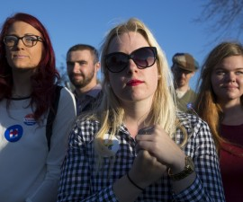 "Briannie Kraft, 22, of Coralville, Iowa, listens as Democratic presidential candidate Hillary Clinton speaks during the ""Fighting for Us"" town hall event in Coralville, Iowa, November 3, 2015. REUTERS/Scott Morgan - RTX1UN0I Related words: millennial, women, millennials, young, Hillary Clinton supporters, feminist"