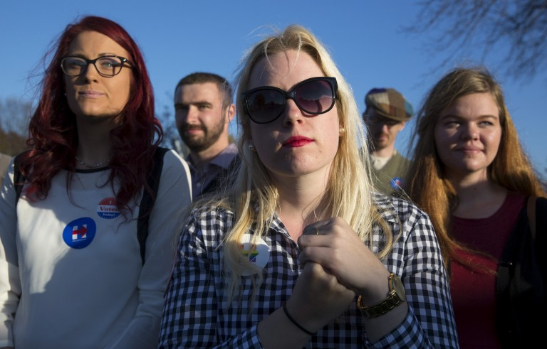 """Briannie Kraft, 22, of Coralville, Iowa, listens as Democratic presidential candidate Hillary Clinton speaks during the """"Fighting for Us"""" town hall event in Coralville, Iowa, November 3, 2015. REUTERS/Scott Morgan - RTX1UN0I Related words: millennial, women, millennials, young, Hillary Clinton supporters, feminist"""