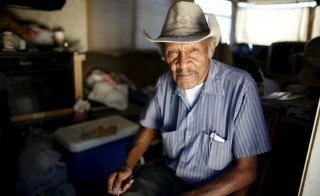 "Samuel Cole, 85, poses for a portrait in the motorhome in which he lives on the streets of Los Angeles, California, United States, November 12, 2015. Cole is a retired truck driver who began living in his motorhome two years ago when he couldn't afford the $100 rise in his rent. Los Angeles is grappling with a massive homelessness problem, as forecasted El Nino downpours threaten to add to the misery of thousands of people who sleep on the streets. Mayor Eric Garcetti has proposed spending $100 million to combat the problem in the sprawling metropolis but stopped short of declaring a state of emergency. REUTERS/Lucy Nicholson PICTURE 8 OF 17 - SEARCH ""NICHOLSON MOTORHOME"" FOR ALL IMAGES   TPX IMAGES OF THE DAY            - RTX1ZL4X RElated words: senior, older, man, seniors, social security, medicare, retirement"