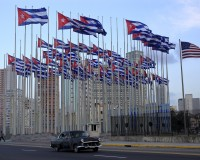 Cuban flags fly near U.S flag beside the U.S embassy in Havana December 31, 2015. REUTERS/Enrique de la Osa - RTX20OVT