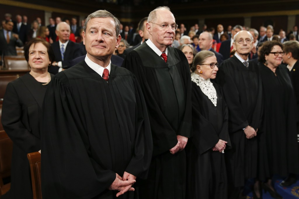 U.S. Supreme Court Justices, including Chief Justice John Roberts (L), arrive in the House chamber prior to U.S. President Barack Obama's final State of the Union address to a joint session of Congress in Washington January 12, 2016. Evan Vucci/Reuters