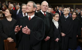 "U.S. Supreme Court Justices, including Chief Justice John Roberts (L), arrive in the House chamber prior to U.S. President Barack Obama's final State of the Union address in Washington, D.C. Speaking from Boston on Wednesday, Roberts said the Supreme Court justices ""don't work as Republicans or Democrats."" Photo by Evan Vucci/Reuters"