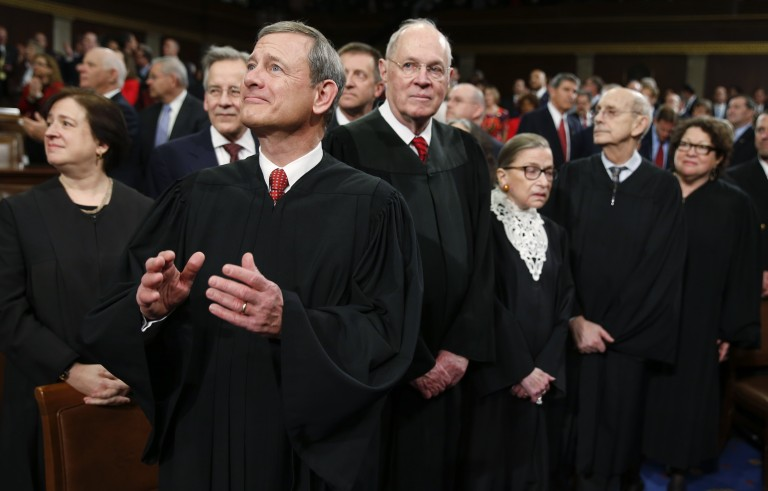 """U.S. Supreme Court Justices, including Chief Justice John Roberts (L), arrive in the House chamber prior to U.S. President Barack Obama's final State of the Union address in Washington, D.C. Speaking from Boston on Wednesday, Roberts said the Supreme Court justices """"don't work as Republicans or Democrats."""" Photo by Evan Vucci/Reuters"""