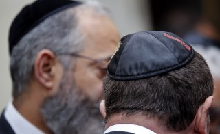 Men wear a kippa, the traditional Jewish skullcap as they attend a visit of French Interior Minister Bernard Cazeneuve at a Synagogue after an attack in front of a Jewish school in Marseille's 9th district, France, January 14, 2016. The teenager who attacked a Jewish teacher in Marseille on Monday is a Turkish citizen of Kurdish origin who said he acted in the name of the militant Islamist group Islamic State, the prosecutor in the southern French city of Marseille said.   REUTERS/Jean-Paul Pelissier - RTX22F3S
