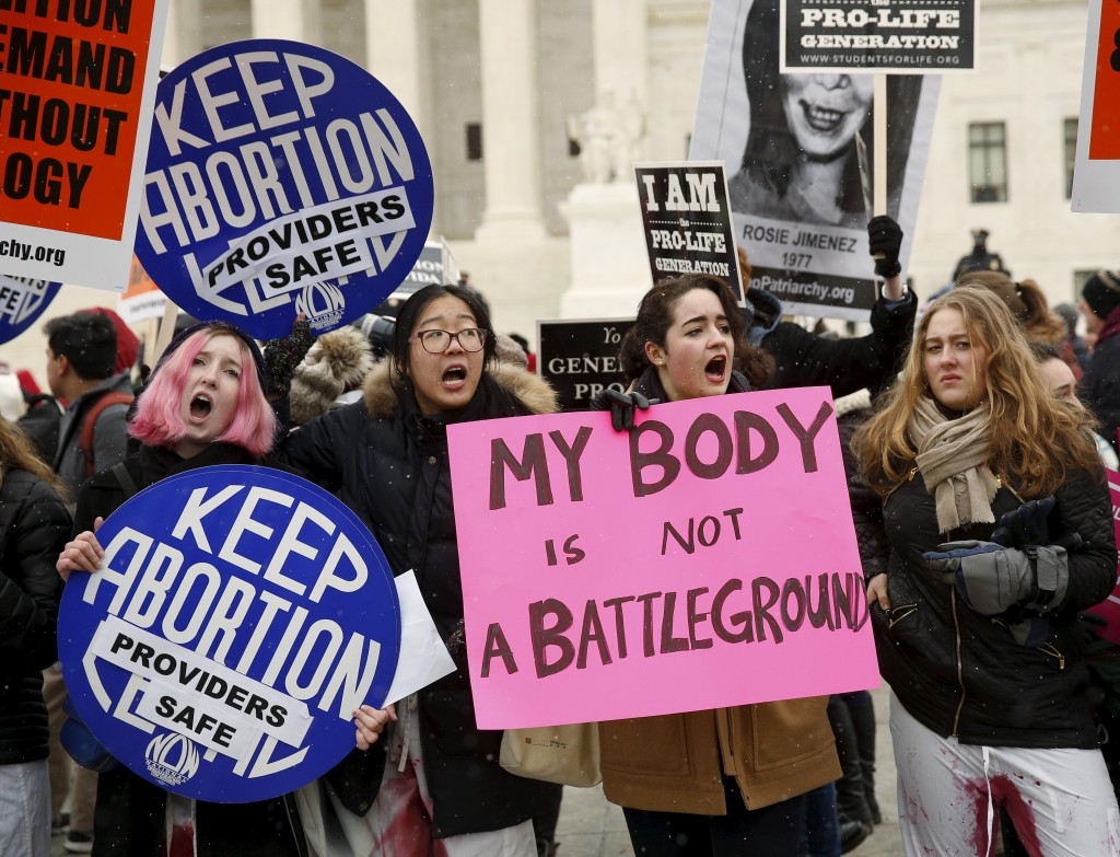 Pro-abortion supporters demonstrate in front of the U.S. Supreme Court during the National March for Life rally in Washington, Jan. 22, 2016. The rally marks the 43rd anniversary of the U.S. Supreme Court's 1973 abortion ruling in Roe v. Wade. Photo by Gary Cameron/Reuters