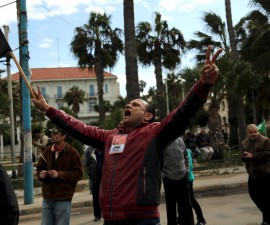A pro-government protester chants slogans as they gather in Al-Qaed Ibrahim area in Alexandria, the city's equivalent of Cairo's Tahrir Square, during the fifth anniversary of the uprising that ended the 30-year reign of Hosni Mubarak, Egypt, January 25, 2016.  REUTERS/Asmaa Waguih   - RTX23Y6I