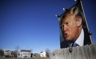 A large poster of U.S. Republican presidential candidate Donald Trump is displayed in a residential neighborhood in Des Moines, Iowa. Photo by Brian Snyder/Reuters