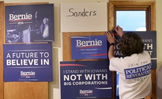 Heather Malmberg hangs signs of support for Bernie Sanders at the home of Gary and Mary Weaver before the caucus in Rippey, Iowa, Monday night. Photo by Nick Oxford/Reuters