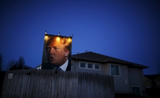 A picture of U.S. Republican presidential candidate Donald Trump hangs outside a house in West Des Moines, Iowa, United States, January 15, 2016. Picture taken January 15, 2016.    REUTERS/Jim Young        TPX IMAGES OF THE DAY      - RTX2502Y