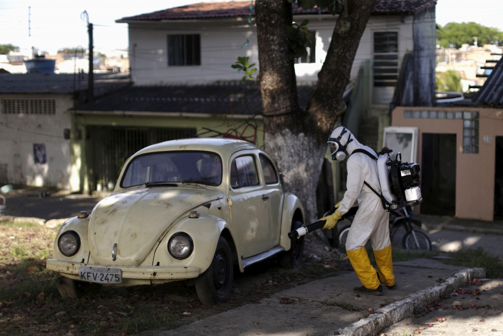 A municipal worker sprays insecticide at the neighborhood of Afogados in Recife, Brazil, February 2, 2016. The operation is part of the city's effort to prevent the spread of Zika's vector, the Aedes aegypti mosquito, according to a statement from Municipal Health Secretary. Photo by Ueslei Marcelino/REUTERS