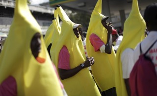 Supporters of presidential candidate and banana exporter Jovenel Moise march dressed in banana costumes against the plan to further delay a presidential run-off election in Port-au-Prince, Haiti, on Feb. 2. Photo by Andres Martinez Casares/Reuters