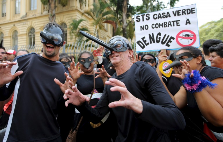 Revellers wear mosquito masks in a reference to the Aedes aegypti mosquito, which can spread dengue as well as the Zika virus, during a street carnival in Sao Paulo, Brazil, February 4, 2016. REUTERS/Paulo Whitaker - RTX25I6U