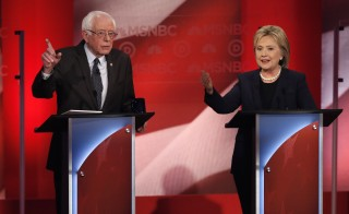 Democratic U.S. presidential candidate Senator Bernie Sanders (L) and former Secretary of State Hillary Clinton discuss an issue during the Democratic presidential candidates debate sponsored by MSNBC at the University of New Hampshire in Durham, New Hampshire, February 4, 2016. REUTERS/Mike Segar - RTX25IVM