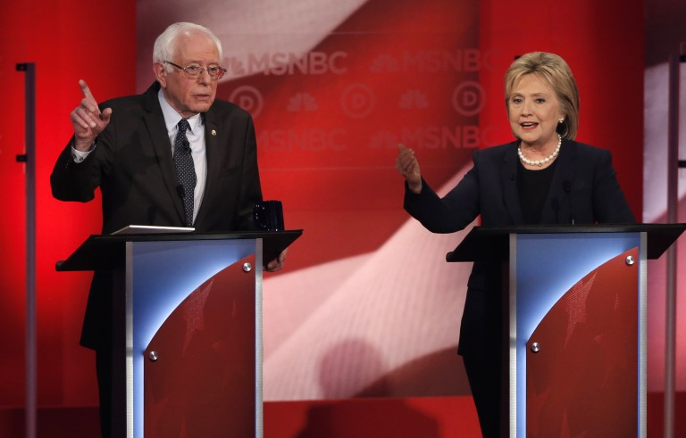 Democratic U.S. presidential candidate Senator Bernie Sanders (L) and former Secretary of State Hillary Clinton spar during the Democratic presidential candidates debate sponsored by MSNBC at the University of New Hampshire on February 4, 2016. Trailing rival Sanders,  Clinton seeks to summon another comeback Mike Segar/Reuters