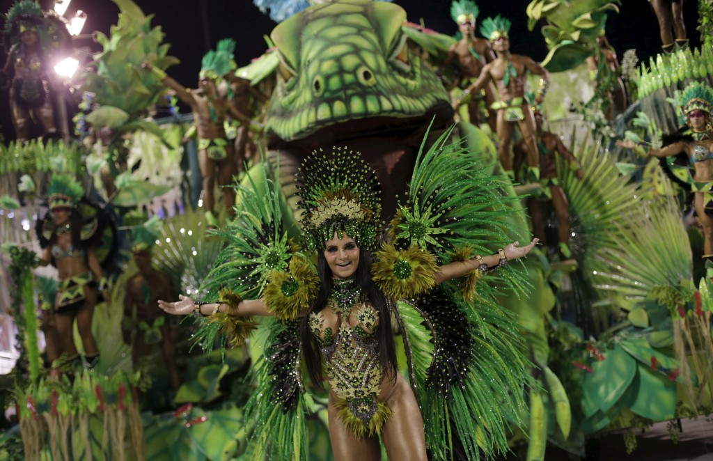A reveller from the Rocinha samba school dances as she takes part in the Group A category of the annual Carnival parade          in Rio de Janeiro's Sambadrome, Brazil, February 5, 2016.  REUTERS/Ricardo Moraes - RTX25OGS