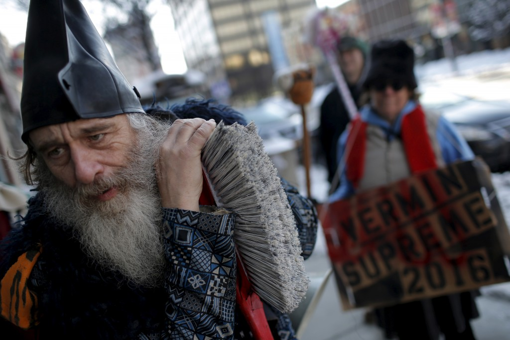Vermin Supreme, a candidate for U.S. president campaigns along Elm Street in downtown Manchester, New Hampshire. Vermin Supreme is officially registered as a presidential candidate with the state of New Hampshire for the 2016 presidential primary election. Photo by Mike Segar/Reuters