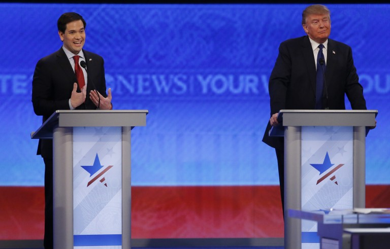 Republican U.S. presidential candidate Senator Marco Rubio (L) reacts to an attack from rival candidate and businessman Donald Trump (R) during the Republican U.S. presidential candidates debate sponsored by ABC News at Saint Anselm College in Manchester, New Hampshire February 6, 2016.     REUTERS/Carlo Allegri - RTX25SML