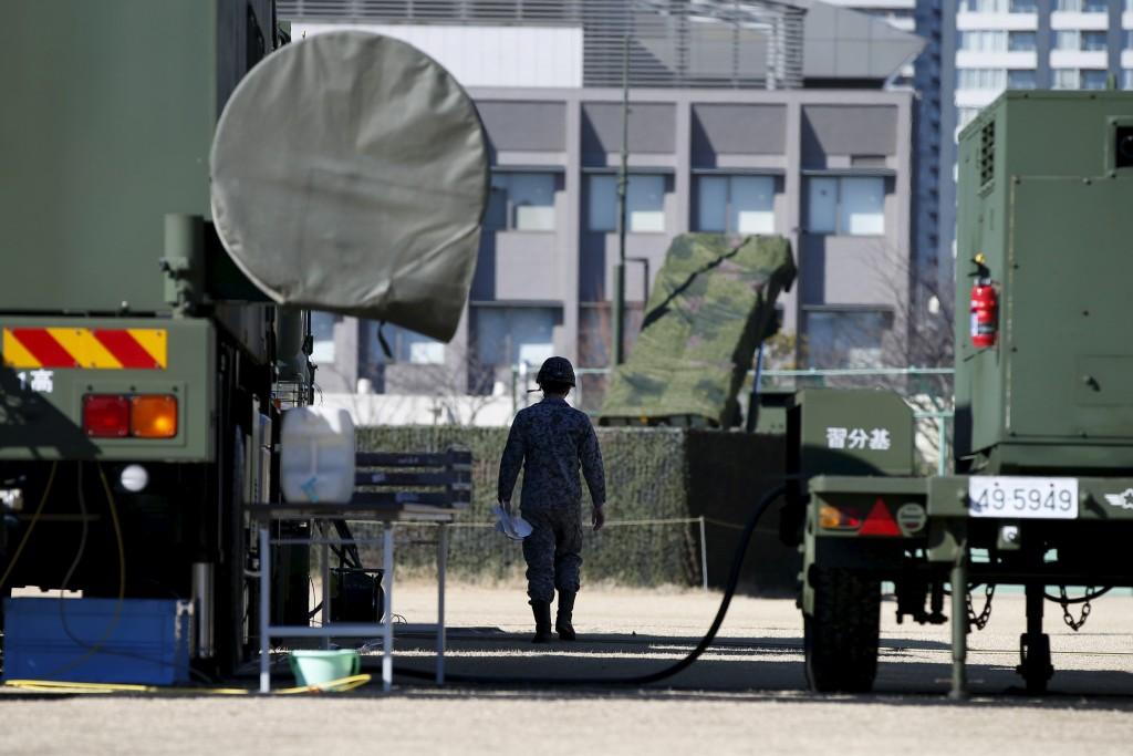 A Japanese Self-Defence Force's soldier walks between the unit of Patriot Advanced Capability-3 (PAC-3) missiles at Defense          Ministry in Tokyo February 7, 2016. North Korea launched a long-range rocket on Sunday carrying what it has said is a satellite,          South Korea's defense ministry said, in defiance of United Nations sanctions. Toru Hanai/Reuters