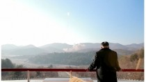 North Korean leader Kim Jong Un watches a long range rocket launched into the air in this still image taken from KRT footage and released by Yonhap on February 7, 2016.  REUTERS/Yonhap ATTENTION EDITORS - THIS PICTURE WAS PROVIDED BY A THIRD PARTY. REUTERS IS UNABLE TO INDEPENDENTLY VERIFY THE AUTHENTICITY, CONTENT, LOCATION OR DATE OF THIS IMAGE. THIS PICTURE IS DISTRIBUTED EXACTLY AS RECEIVED BY REUTERS, AS A SERVICE TO CLIENTS. FOR EDITORIAL USE ONLY. NOT FOR SALE FOR MARKETING OR ADVERTISING CAMPAIGNS. FOR EDITORIAL USE ONLY. NO RESALES. NO ARCHIVE. SOUTH KOREA OUT. NO COMMERCIAL OR EDITORIAL SALES IN SOUTH KOREA.      TPX IMAGES OF THE DAY - RTX25T00