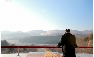 North Korean leader Kim Jong Un watches a long range rocket launched into the air in this still image taken from KRT footage and released by Yonhap on Feb. 7, 2016. Photo by Yonhap via Reuters