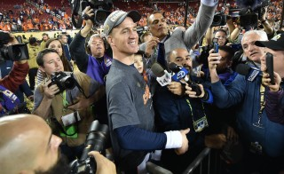 Feb 7, 2016; Santa Clara, CA, USA; Denver Broncos quarterback Peyton Manning leaves the stadium after the game with his son Marshall Manning after the game against the Carolina Panthers in Super Bowl 50 at Levi's Stadium. The Broncos won 24-10. Mandatory Credit: Kyle Terada-USA TODAY Sports - RTX25X0B