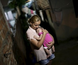 "Gleyse Kelly da Silva embraces her daughter Maria Giovanna, who has microcephaly, in Recife, Brazil, January 25, 2016. Reuters Photographer Ueslei Marcelino: ""Gleyse Kelly da Silva was seven months pregnant when an ultrasound showed her baby's head had stopped growing. Maria Giovanna, now three months, has microcephaly, a deformation characterised by abnormally small heads that can also include brain damage. The condition is suspected to be linked to the mosquito-borne Zika virus, which the World Health Organization has declared a public health emergency. My colleagues and I spent a day with Silva and her family at their home in Recife, eastern Brazil, which is at the centre of a crisis overwhelming local authorities. Silva, a 27-year-old toll-booth worker, became ill in April with a fever, back pain, itching and a rash. 'When I saw her the first time I cried,' Silva said. 'I saw my perfect daughter and thanked God. It was a feeling of love, happiness.' Such an assignment is delicate; you have to be respectful. I felt a responsibility to share their story and highlight the problem. Doctors took blood samples, as well as liquid from the baby's spine, for tests. Silva and Maria Giovanna's father, Felipe Marques, are still awaiting the results. Silva hopes her daughter will not suffer any severe consequences and that she will grow up to walk, talk and play with other children. 'I cannot believe it when the doctors say she will not walk,' Silva said. 'I need to believe that everything will be all right.'"" REUTERS/Ueslei Marcelino SEARCH ""GLEYSE KELLY"" FOR ALL IMAGES   TPX IMAGES OF THE DAY      TPX IMAGES OF THE DAY      - RTX26026"