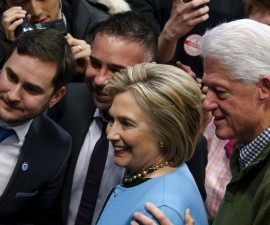 Democratic U.S. presidential candidate Hillary Clinton (L) and former U.S. President Bill Clinton pose with supporters during a campaign stop at Manchester Community College in Manchester, New Hampshire February 8, 2016.  REUTERS/Adrees Latif - RTX2620U