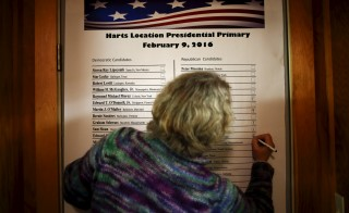 An official labels the number of votes candidates received in Hart's Location, New Hampshire Tuesday. The community of Hart's Location is one of three tiny New Hampshire towns that cast the state's first votes of the primary, as the clock strikes midnight. Photo by Adrees Latif/Reuters