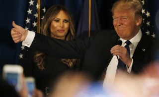 Republican presidential candidate Donald Trump stands with his wife Melania at his New Hampshire primary night rally in Manchester on Feb. 9. Photo by Jim Bourg/Reuters