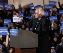 Democratic U.S. presidential candidate Bernie Sanders smiles as he waves to the crowd at his 2016 New Hampshire presidential primary victory rally in Concord, New Hampshire February 9, 2016. REUTERS/Shannon Stapleton - RTX269RG