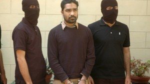 Security officials escort arrested terror suspect Farooq Bhatti, also known as Musanna, in front of the media in Karachi, Pakistan February 12, 2016. Pakistan has arrested 97 al-Qaeda and Lashkar-e-Jhangvi militants, including three commanders, in the southern city of Karachi and foiled a planned attack to break U.S. journalist Daniel Pearl's killer out of jail, the army said on Friday. REUTERS/Sahib Zaman/APP/Handout via Reuters    ATTENTION EDITORS - THIS PICTURE WAS PROVIDED BY A THIRD PARTY. REUTERS IS UNABLE TO INDEPENDENTLY VERIFY THE AUTHENTICITY, CONTENT, LOCATION OR DATE OF THIS IMAGE. EDITORIAL USE ONLY. NOT FOR SALE FOR MARKETING OR ADVERTISING CAMPAIGNS. NO RESALES. NO ARCHIVE. THIS PICTURE IS DISTRIBUTED EXACTLY AS RECEIVED BY REUTERS, AS A SERVICE TO CLIENTS. PAKISTAN OUT. NO COMMERCIAL OR EDITORIAL SALES IN PAKISTAN - RTX26N4F