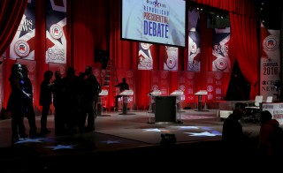 Technicians prepare the stage for a Republican presidential candidates debate moderated by CBS News in Greenville, South Carolina February 13, 2016. Photo by Jonathan Ernst/Reuters.