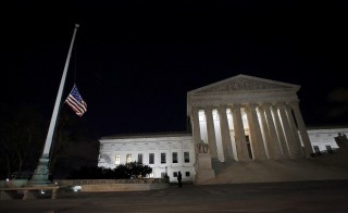 Capitol Hill police officers lower the U.S. flag at the Supreme Court in Washington D.C. after the death of U.S. Supreme Court Justice Antonin Scalia, February 13, 2016. Conservative Justice Scalia, 79, has died, Texas Governor Greg Abbott said. The San Antonio News-Express said Scalia had apparently died of natural causes while visiting a luxury resort in West Texas.   REUTERS/Carlos Barria      TPX IMAGES OF THE DAY      - RTX26TFV