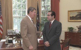 U.S. President Ronald Reagan speaks with Supreme Court Justice nominee Antonin Scalia (R) in the White House Oval Office in Washington, DC in a July 7, 1986 file photo courtesy of the Ronald Reagan Library. Conservative U.S. Supreme Court Justice Antonin Scalia has died, setting up a major political showdown between President Barack Obama and the Republican-controlled Senate over who will replace him just months before a presidential election. REUTERS/Bill Fitz-Patrick/White House/Courtesy Ronald Reagan Library/Handout via Reuters   ATTENTION EDITORS - THIS PICTURE WAS PROVIDED BY A THIRD PARTY. REUTERS IS UNABLE TO INDEPENDENTLY VERIFY THE AUTHENTICITY, CONTENT, LOCATION OR DATE OF THIS IMAGE. FOR EDITORIAL USE ONLY. NOT FOR SALE FOR MARKETING OR ADVERTISING CAMPAIGNS. THIS PICTURE IS DISTRIBUTED EXACTLY AS RECEIVED BY REUTERS, AS A SERVICE TO CLIENTS - RTX26TIO