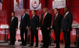 The remaining Republican U.S. presidential candidates, (L-R) Governor John Kasich, former Governor Jeb Bush, Senator Ted Cruz, businessman Donald Trump, Senator Marco Rubio and Dr. Ben Carson pose before the start of the Republican U.S. presidential candidates debate sponsored by CBS News and the Republican National Committee in Greenville, South Carolina February 13, 2016. Jonathan Ernst/Reuters